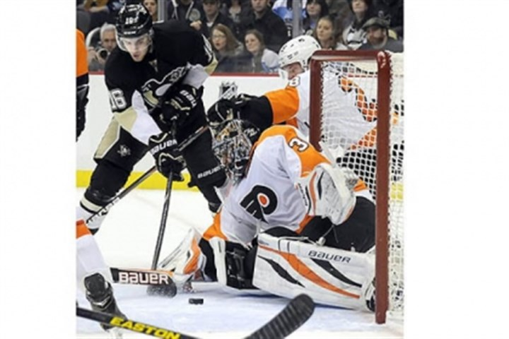 Ilya Bryzgalov The Penguins' Brandon Sutter scores the tying goal against Flyers goaltender Ilya Bryzgalov in the third period at Consol Energy Center Wednesday night.