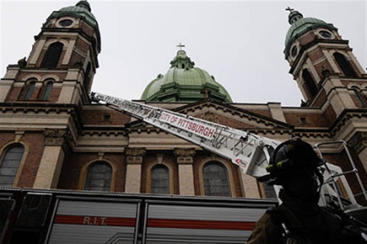 Immaculate Heart of Mary church Fire companies respond to a two-alarm fire at Immaculate Heart of Mary church in Polish Hill after reports of lightning striking the church's center dome around 5:30 p.m.