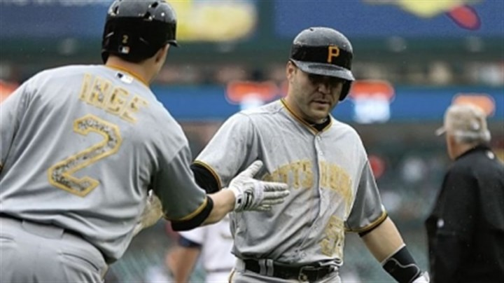inge Brandon Inge congratulates catcher Russell Martin after Martin scored the Pirates' fifth run in the eighth inning against the Tigers.