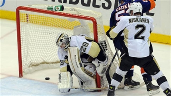 Islanders' Casey Cizikas The Islanders' Casey Cizikas scores on Penguins goaltender Marc-Andre Fleury late in the third period.