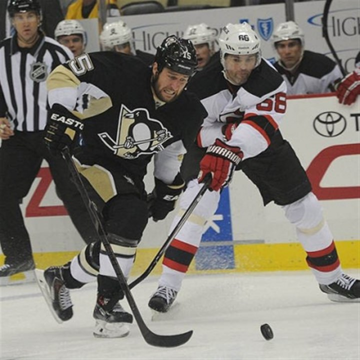 jagr Tanner Glass and Jaromir Jagr fight for the puck Thursday at Consol Energy Center.