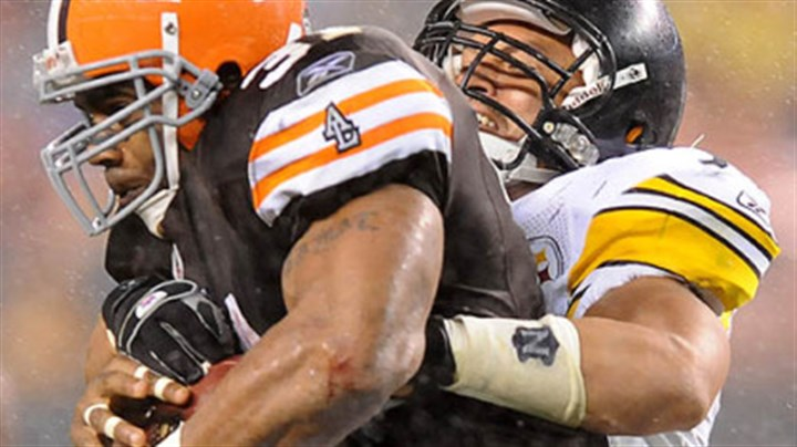 Jamal James Farrior stops the Browns' Jamal Lewis for a short gain.