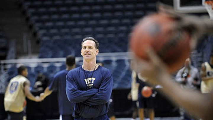 Jamie Dixon Pitt head coach Jamie Dixon protests as a foul is called on Jermaine Dixon.
