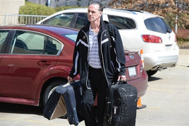 JamieDixon Pitt coach Jamie Dixon gathers his bags before the team heads to Salt Lake City for a first-round game against Wichita State.