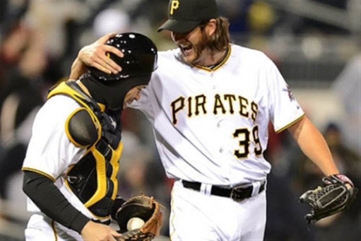 Jason Grilli and Russell Martin Pirates closer Jason Grilli celebrates with catcher Russell Martin after beating the Cubs 3-0.