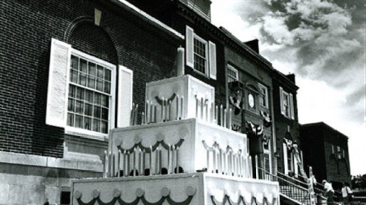 Jeannette 3 This Pittsburgh Press file photo by Ross Catanza on June 9, 1988, shows a 1 1/2-story wooden cake in front of the Jeannette Borough Building. The cake, made of wood, was built to honor the town's 100th birthday.