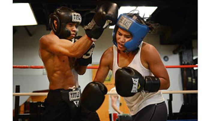 Jennifer Dugwen Chieng and Amonte Eberhardt Jennifer Dugwen Chieng takes a hit from Amonte Eberhardt, 21, as they spar Tuesday at the Third Avenue Gym. Ms. Chieng says she usually spars with men as part of her training routine.