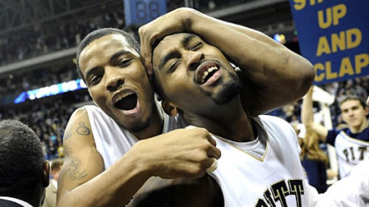 Jermaine Dixon and Brad Wanamaker Pitt guard Jermaine Dixon hugs exhausted guard Brad Wanamaker after defeating West Virginia in triple overtime at the Petersen Events Center Friday.