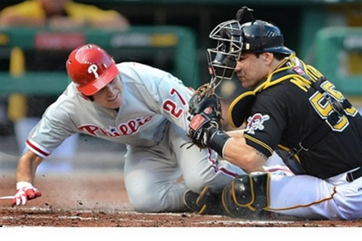 John Lannan and Russell Martin The Phillies' John Lannan is tagged out at home by Pirates catcher Russell Martin at PNC Park.