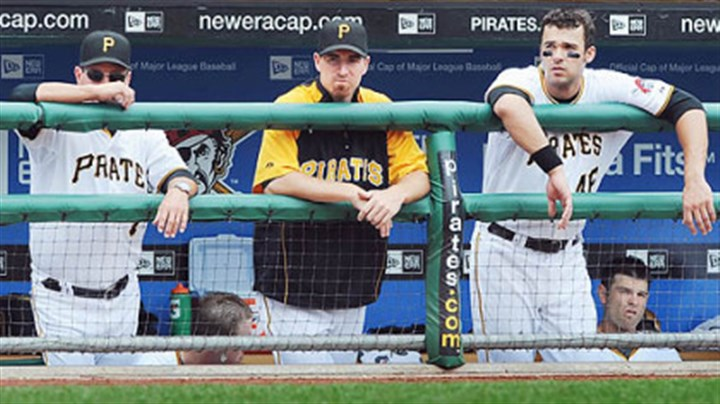 John Russell, Adam LaRoche and Garrett Jones Former Pirates first baseman Adam LaRoche, middle, stands in the dugout next to manager John Russell, left, and his replacement, Garrett Jones.