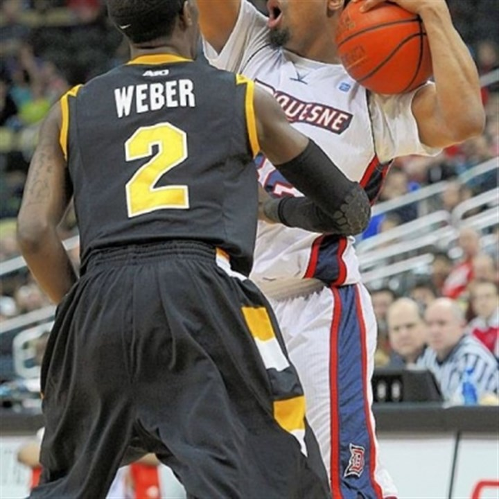 Johnson Duquesne's Sean Johnson looks for an open man while being guarded by Virginia Commonwealth's Briante Weber in an Atlantic 10 game Saturday night at Consol Energy Center.