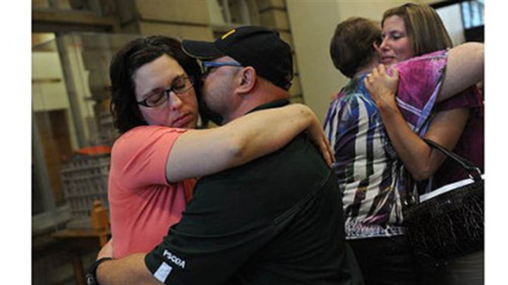 Joy Burkholder Joy Burkholder, left, receives a hug from her husband, Lance, Thursday after Melvin Knight was sentenced to death for the torture and murder of Jennifer Daugherty at the Westmoreland County Courthouse in Greensburg. Ms. Burkholder is Jennifer's sister. Heather Smitley, right, hugs Daugherty's mother, Denise Murphy.