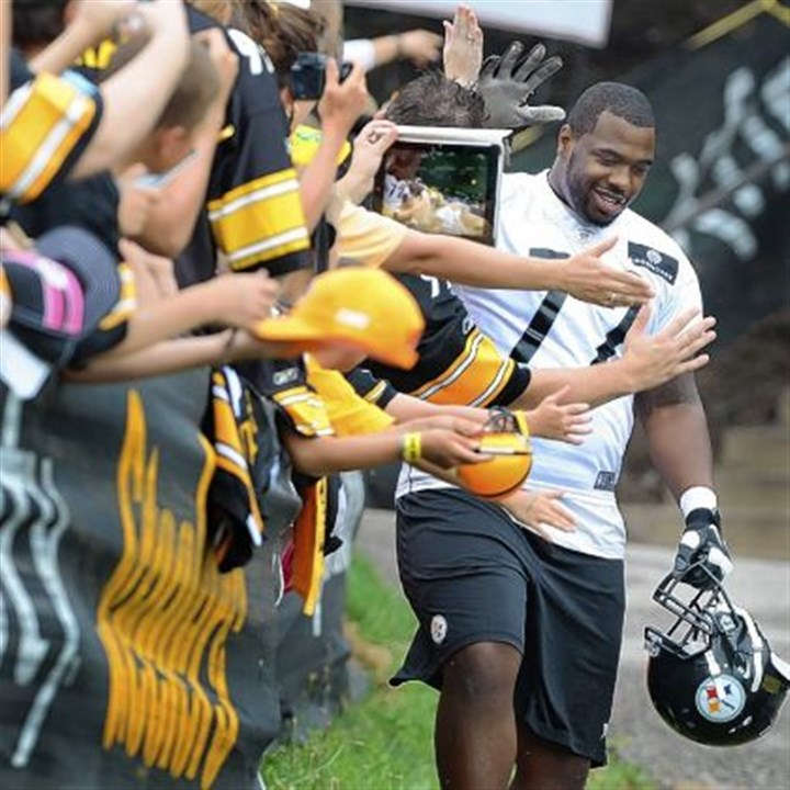 Justin Cheadle Steelers guard Justin Cheadle high-fives fans on his way to the field for the start of the second day of camp Saturday at Saint Vincent College.