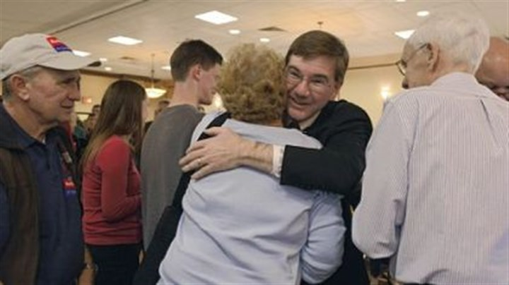 Keith Rothfus Republican Keith Rothfus, left, hugs a supporter Tuesday night at the Holiday Inn in Ross after winning his congressional seat.