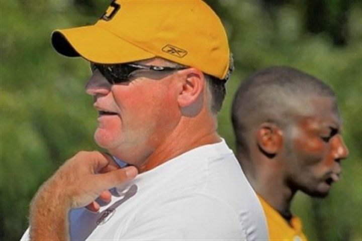 Kevin Colbert Kevin Colbert, General Manager of the Pittsburgh Steelers surveys a training camp practice in 2011 while safety Ryan Clark walks by behind him.