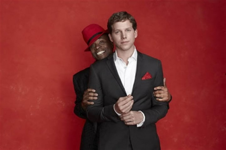 "'Kinky Boots' Billy Porter peeks over the shoulder of his ""Kinky Boots"" co-star Stark Sands. The show, which opens in previews March 4, is part of the Post-Gazette's 97th Show Plane."