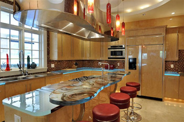 Kitchensaa The kitchen has curly maple cabinets with a special acrylic finish and lighted glass countertops.