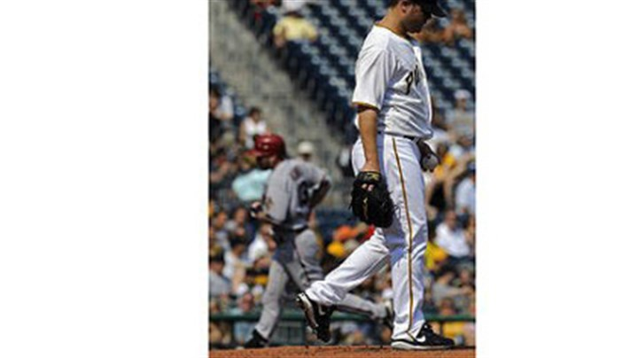 kubel Diamondbacks' Jason Kubel heads toward third base after hitting a two-run home run against Pirates' Wandy Rodriguez in the first inning at PNC Park Thursday afternoon.