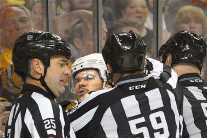 kunitz Chris Kunitz argues that he was tripped by the Bruins' Brad Marchand Wednesday at TD Garden in Boston.
