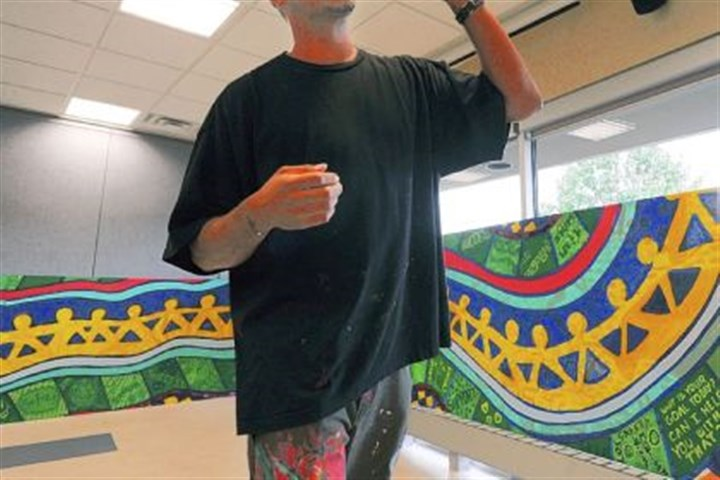 Kyle Holbrook Kyle Holbrook, from Moving Lives of Kids, is a professional muralist who specializes in working with at-risk youth. Mr. Holbrook collaborated with Auberle students to create the six large murals.