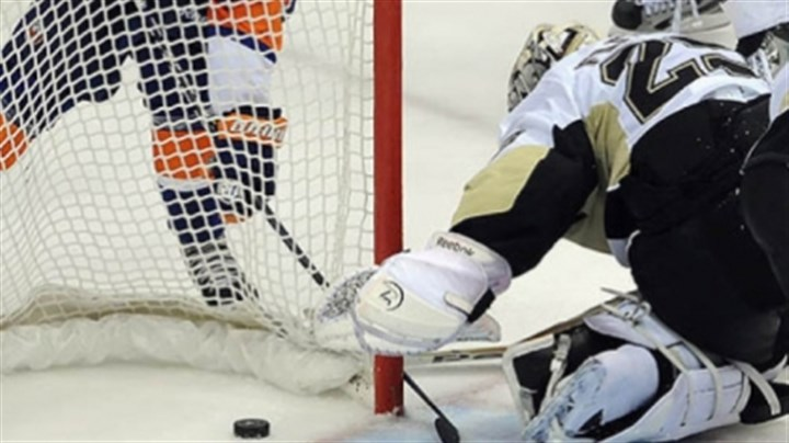 Kyle Okposo Penguins goaltender Marc-Andre Fleury tries to stop a shot by the Islanders' Kyle Okposo in the second period.