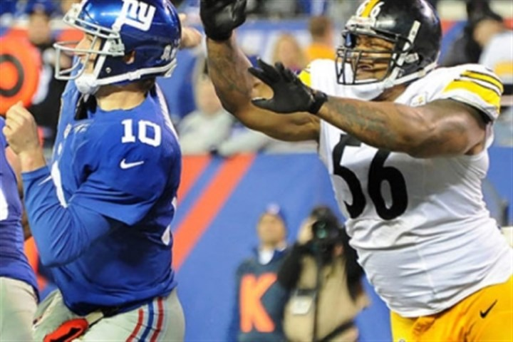 LaMarr Woodley Steelers outside linebacker LaMarr Woodley knocks ball out of Giants quarterback Eli Mannings hands during a game last season.