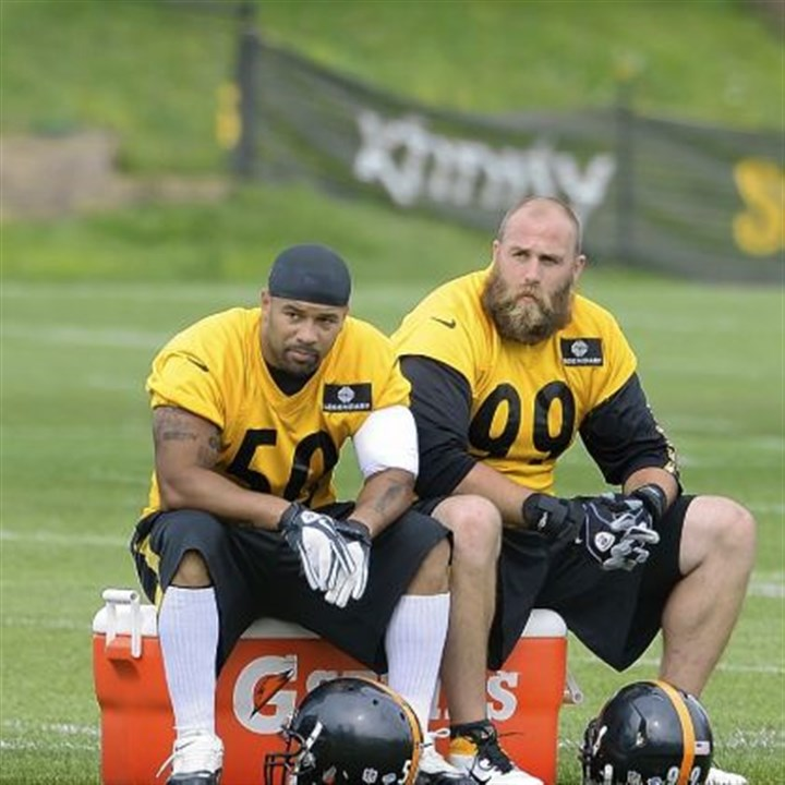 Larry Foote and Brett Keisel Larry Foote, left, and Brett Keisel take some down time on the final day of 2013 training camp Saturday at Saint Vincent College in Latrobe, Pa.
