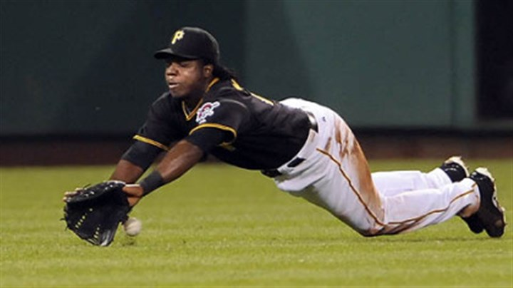 Lastings Milledge Pirates outfielder Lastings Miledge can't come up with a ball hit by Nationals shortstop Cristian Guzman in the eighth inning.