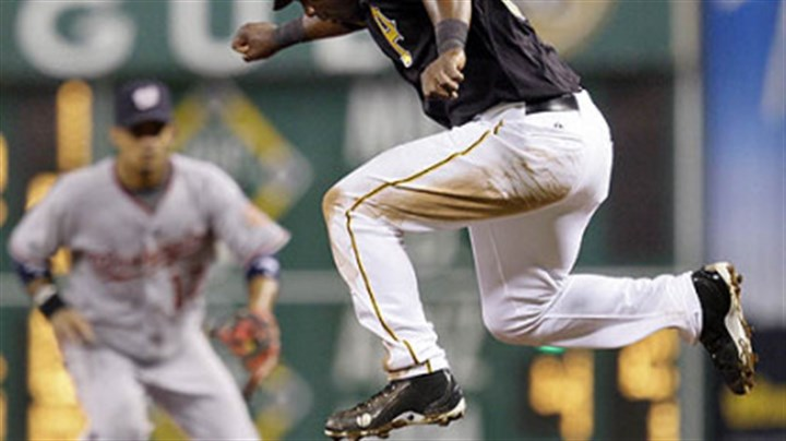 Lastings Milledge Pirates outfielder Lastings Milledge leaps over a ground ball hit to Nationals second baseman Alberto Gonzalez by Pirates outfielder Garrett Jones in the seventh inning. Gonzalez threw to second to get the out on Milledge but Jones was safe at first.