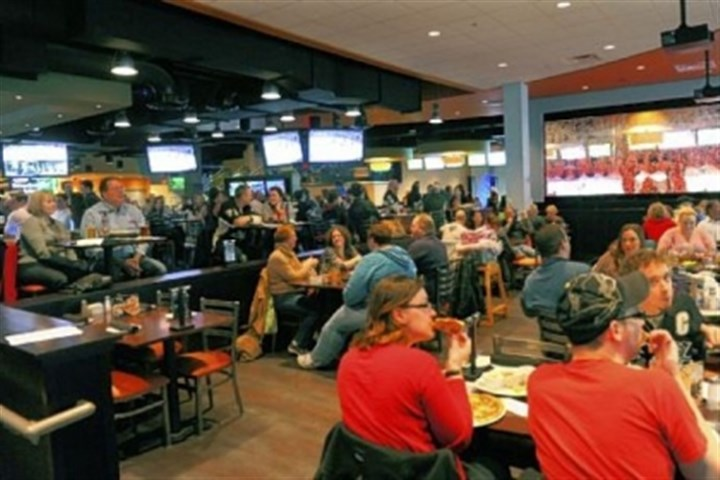 Latitude 40 Patrons can eat and watch the Penguins game on big screens at the Sports Theater on the first floor.