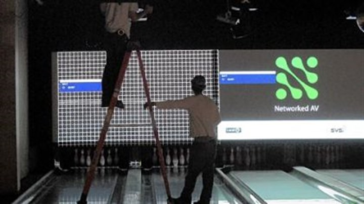 Latitude 40 Construction workers install equipment in the bowling lanes at Latitude 40 in North Fayette.