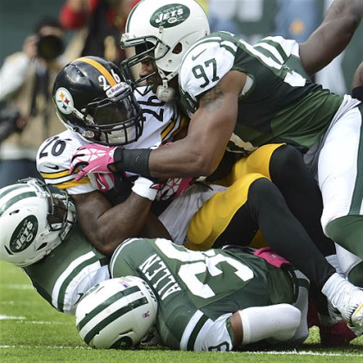Le'Veon Bell Jets linebacker Calvin Pace stops Steelers running back Le'Veon Bell for no gain in the first quarter.