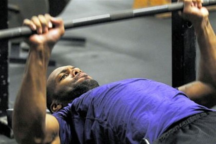 leflore Power defensive back Chris LeFlore does bench presses during a workout at Wright's Gym in Crafton.