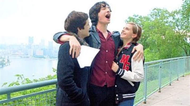"Logan Lerman, Ezra Miller and Emma Watson Logan Lerman, Ezra Miller and Emma Watson are schoolmates in ""The Perks of Being a Wallflower."""