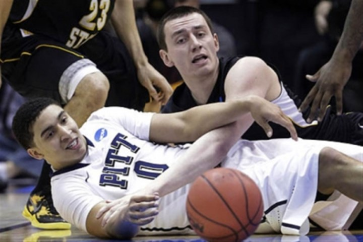 Loose ball Pitt's James Robinson and Wichita State's Jake White go after a loose ball during this afternoon's NCAA tournament game in Salt Lake City. Pitt lost 73-55.