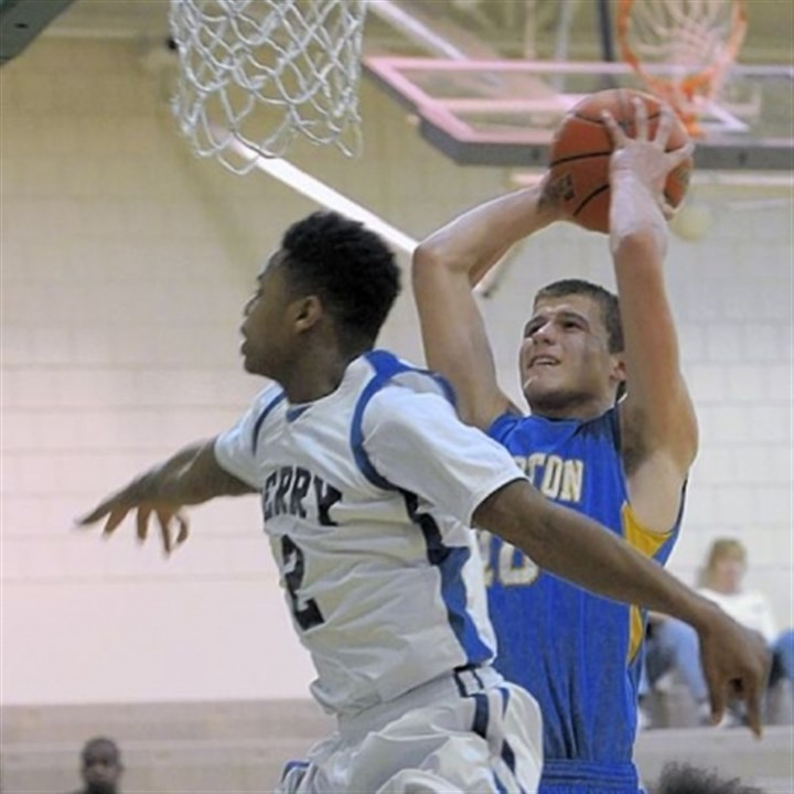 Luther Hampton's Ryan Luther, right, shoots over Perry defender Daron Clark Saturday.