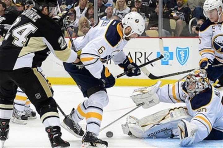 Making a save Sabres' goalie Ryan Miller makes a save on a shot by the Penguins' Matt Cooke in the third period.