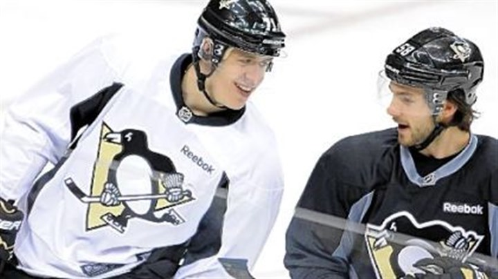 MalkinLetang Evgeni Malkin is getting reacquainted with his teammates, such as Kris Letang, and the North American style of hockey.