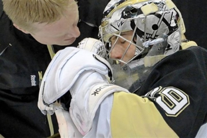 Marc-Andre Fleury Penguins Head Athletic Trainer Chris Stewart looks after goalie Marc-Andre Fleury after the collision with the Canadiens' Tomas Plekanec.