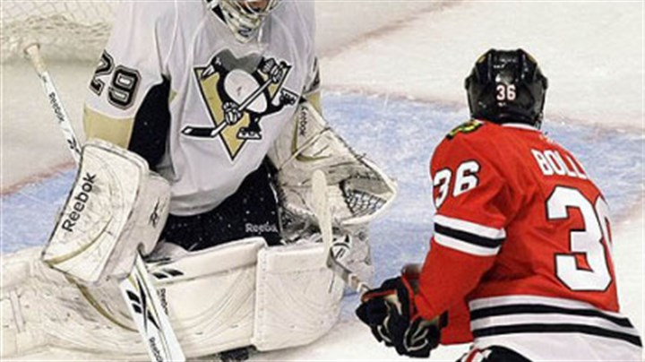 Marc-Andre Fleury Penguins goalie Marc-Andre Fleury, left, makes a pad save on a shot by Chicago Blackhawks center Dave Bolland, right, during the third period of their game in Chicago last night.