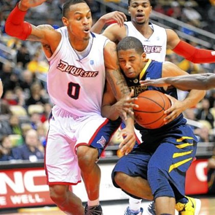 marhold Duquesne Andre Marhold, left, cuts off West Virginia's Gary Browne in first half Tuesday night.