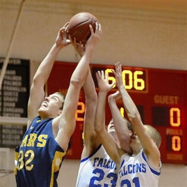 Mars boys Mars center Josh Goetz pulls down a rebound against Connellsville at North Catholic's Don Graham Classic.