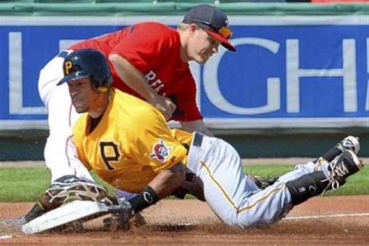 marte Starling Marte slides safely into third Wednesday, avoiding a tag from Boston's Brock Holt in the PIrates' 9-3 win in Fort Myers, Fla.