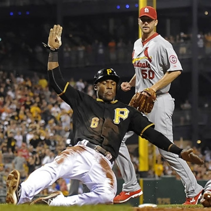 marte slides The Pirates' Starling Marte scores in front of the Cardinals' Adam Wainwright in the fifth inning last night at PNC Park.