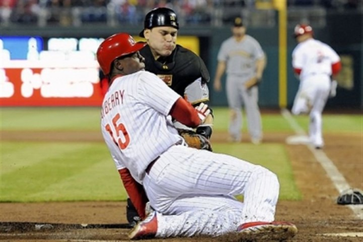 Martin Catcher Russell Martin tags out Philadelphia's John Mayberry Jr. at home plate in the fourth inning Tuesday night in Philadelphia.