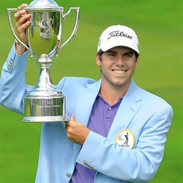 martin Ben Martin, winner of the Mylan Classic golf tournament, hoists the cup after finishing his final round 17-under par, winning by five strokes.