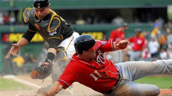 martin Russell Martin is late with the tag as Washington's Ryan Zimmerman scores the go-ahead run in the ninth inning Saturday at PNC Park.