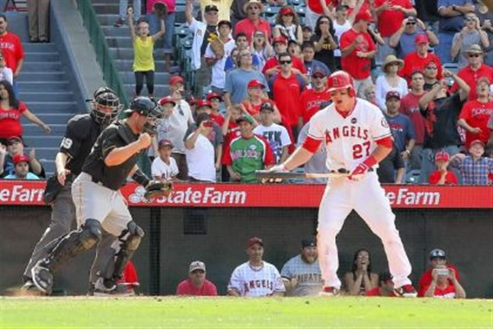 martin Angels outfielder Mike Trout strikes out to end the game as catcher Russell Martin and the Pirates topped Los Angeles, 10-9, on Sunday.