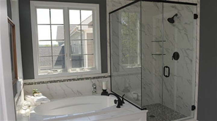Master bath The master bath has a soaking tub, ceramic-tiled shower with heavy glass door and double-bowl sink.