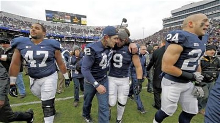 mauti Penn State linebacker Michael Mauti (42) embraces running back Michael Zordich (9) as they walk off the field after a senior recognition ceremony before Saturday's game against Wisconsin in University Park, Pa.